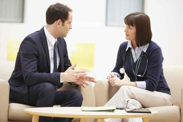 Businessman Discussing Test Results Female Doctor